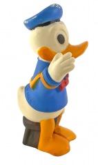 Donald Duck winkend auf Schemel